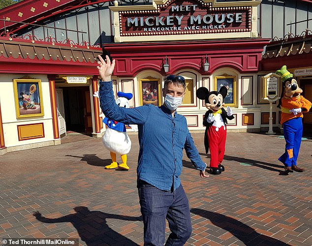 MailOnline Travel had a socially distanced character interaction with Mickey, Donald and Goofy