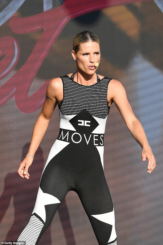 Workout star:Michelle Hunziker showed off her incredible physique on Friday as she led thousands in a fitness performance in Italy
