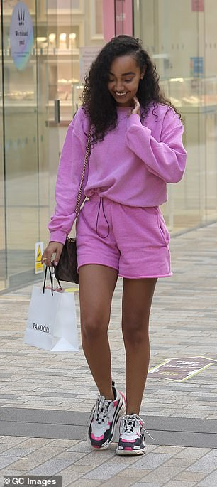 Relaxed: The bubblegum pink sweat shorts were teamed with a matching sweater, while she finished her look with a pair of chunky colourful trainers
