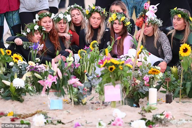 The girlfriend of late Alex 'Chumpy' Pullin paid tribute to his life in a moving dawn memorial (pictured, Ellidy Vlug flanked by family and friends during the morning service on Saturday)