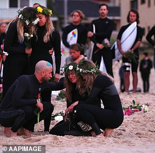Friends are seen comforting Ms Vlug (pictured) on the beach