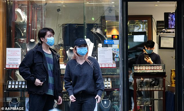 Shoppers in Melbourne are pictured wearing facemasks as testing in the metropolitan are ramps up