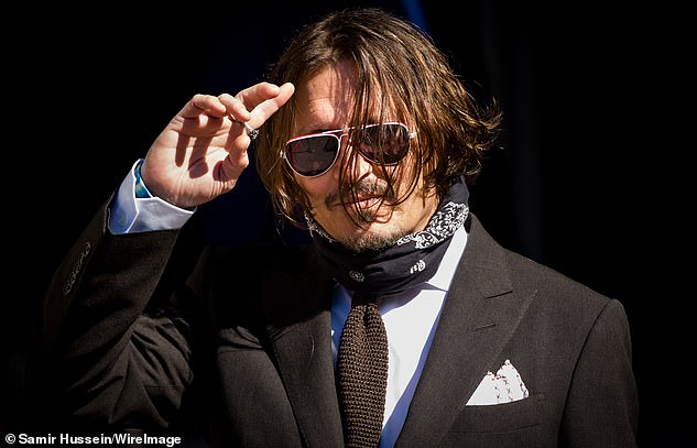 Johnny Depp pictured arriving at the Royal Courts of Justice in Strand, London, in July. The Pirates of the Carribean star is suing The Sun newspaper over an article suggesting he was a 'wife beater'