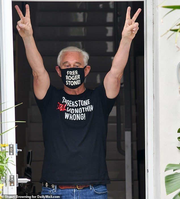 Stone was certainly in a celebratory mood as he posed at the doorstep of his home Saturday. The convicted conservative political strategist is still on house arrest, so was unable to go further than his front gate