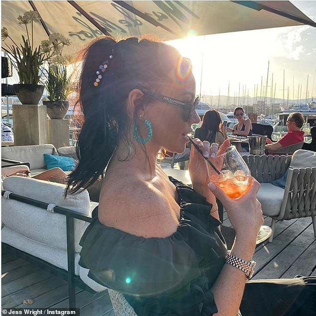 Tranquil: Jess Wright appeared in a reflective mood on Saturday as she sipped on a cocktail during a stunning sunset in Palma, Mallorca