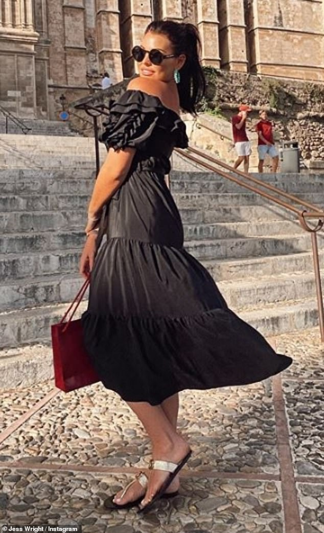 Wow: The former TOWIE star, 34, looked sensational in a strapless black ruffled midi dress as she made the most of her getaway