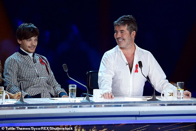 Working relationship: Louis appeared as a judge on Simon's competition show The X Factor in 2018 (pictured), acting as a mentor to the 'Boys' and his mentee Dalton Harris won the show