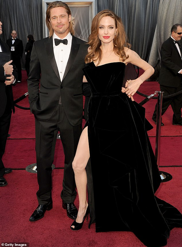 Dynamic duo: They are pictured posing at the 2012 Oscars in Hollywood