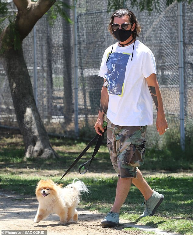 Content lil guy:His pup Chewy looked totally unbothered by the rising temps in Los Angeles as he trotted around the spacious park with his tail in the air