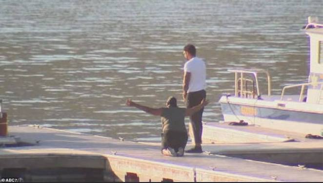 Naya Rivera's distraught mom is seen above with Rivera's brother on the banks of the lake as the search for the missing Glee star entered its fourth day and authorities released footage of the nightmarish underwater hunt