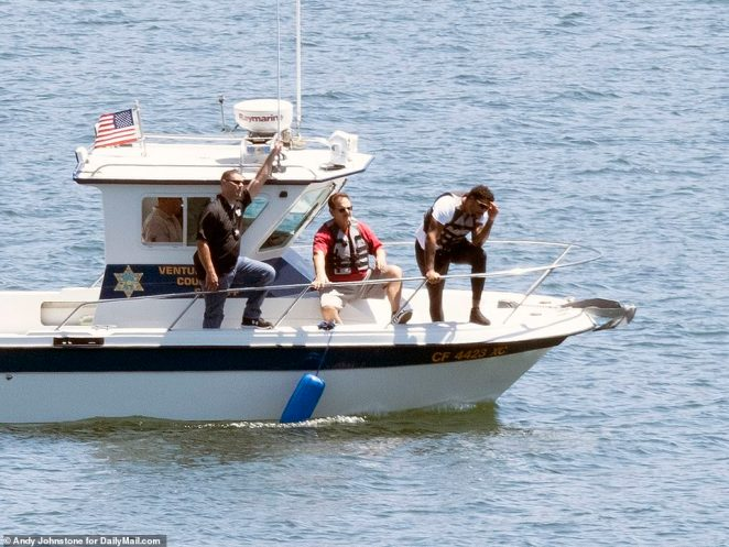 Naya Rivera's brother Mychal is seen at the front of the boat on the fourth day of the search on Saturday