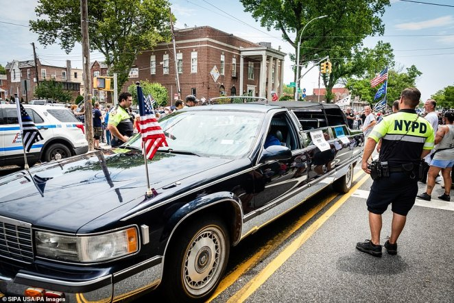 A car with American and thin blue line flags is seen aboveduring a Blue Lives Matter rally in Bay Ridge, Brooklyn, on Saturday