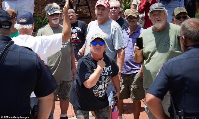 A supporter of the Confederacy makes a gesture during demonstrations and a counter-protest in Graham, North Carolina, on Saturday