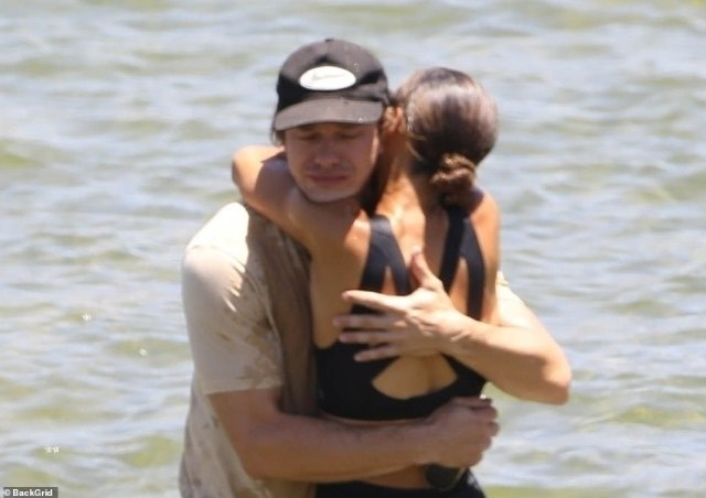 Ryan Dorsey is hugged by one of Naya's Rivera's family members in the lake in a moment of grief