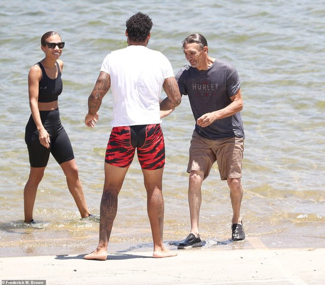 Brother Mychal Rivera together with his father George, right, and a cousin, left, were all seen on the shores of Lake Piru