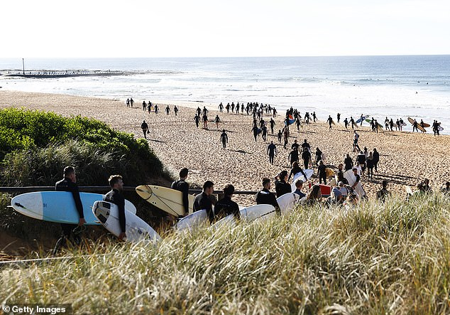 Hundreds of surfers arrived at North Narrabeen beach to say farewell after the initial ceremony in Queensland on Saturday