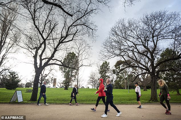 Just in the last 24 hours, police have issued 119 fines to people breaking lockdown rules in Melbourne. Pictured: People get in their government-mandated exercise at the Botanic Gardens in Melbourne on Sunday