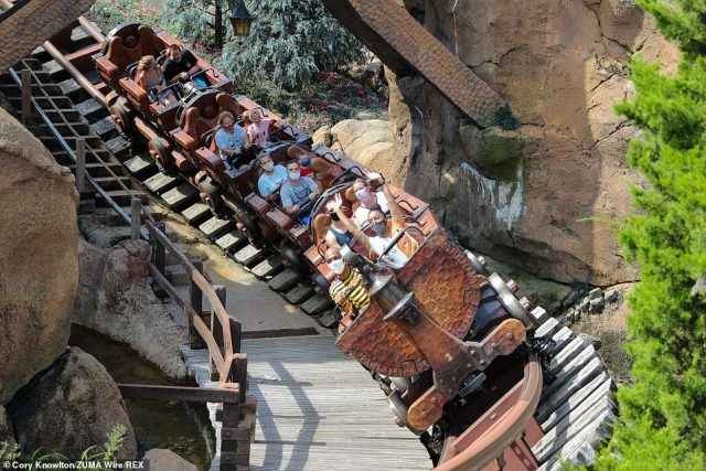 Wearing face masks, guest could once again enjoy rides such as Thunder Mountain