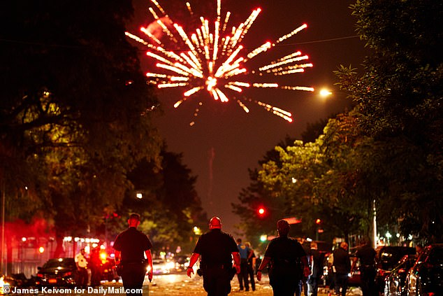 In New York City at least four people were killed and 37 were injured in shootings during July 4th revelry. Police are pictured at the scene where a 23-year-old man was killed in Harlem