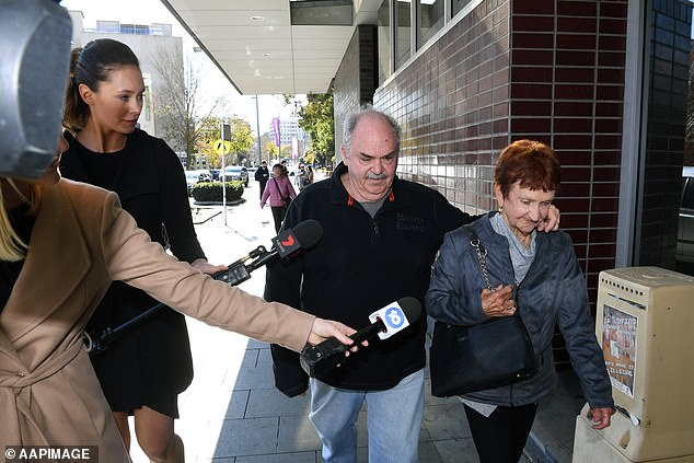 Ms Young's father and grandmother outside Bankstown Local Court on Monday morning as she was refused bail