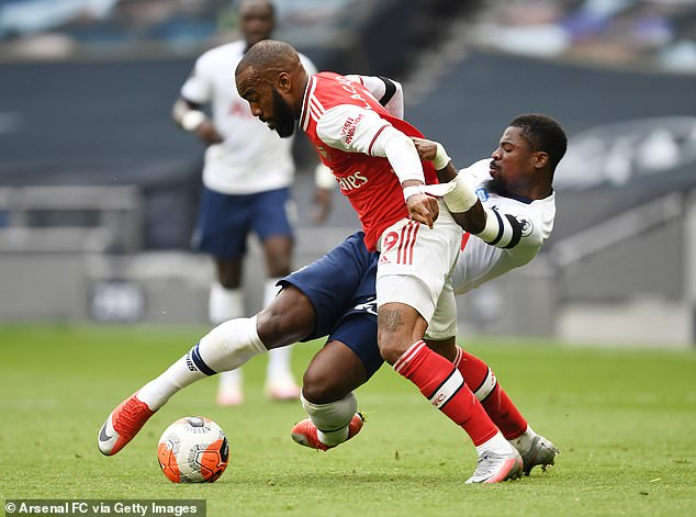Serge Aurier (right) played for Tottenham in his 2-1 Arsenal victory in Sunday's derby
