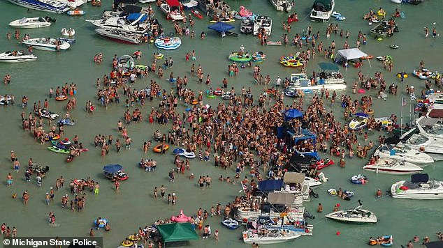 Hundreds of revelers partied the day away on the Fourth of July at the Torch Beach sandbar in Milton Township, Michigan, where they packed onto the sand and crowded in their boats, ignoring orders to social distance