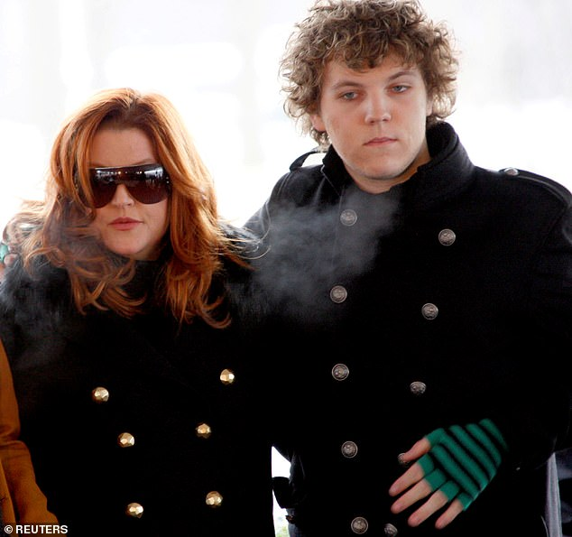 Bereaved Lisa Marie's representative told DailyMail.com: 'She is completely heartbroken, inconsolable and beyond devastated but trying to stay strong for her 11-year-old twins and her oldest daughter Riley. She adored that boy. He was the love of her life.' Pictured: Benjamin and Lisa Marie