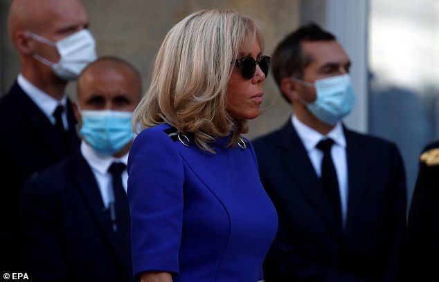 The French first lady rose solemnly during her husband's speech. This year's July 14 celebrations had to be canceled or changed to avoid the risk of spreading the coronavirus