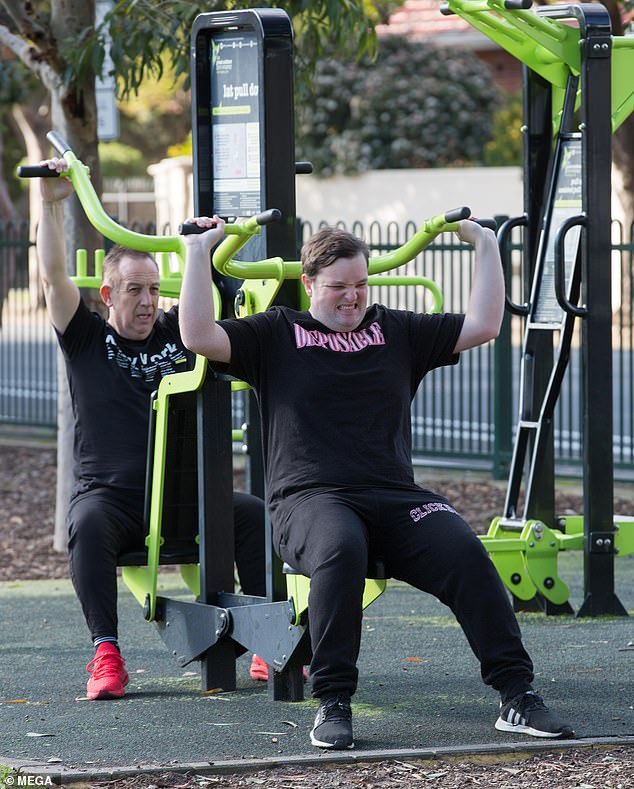 Fit family! Big Brother evictee Kieran Davidson, 21, sweated through a gruelling exercise session in the park with his father in Adelaide on Sunday, after shedding 15kgs on the show