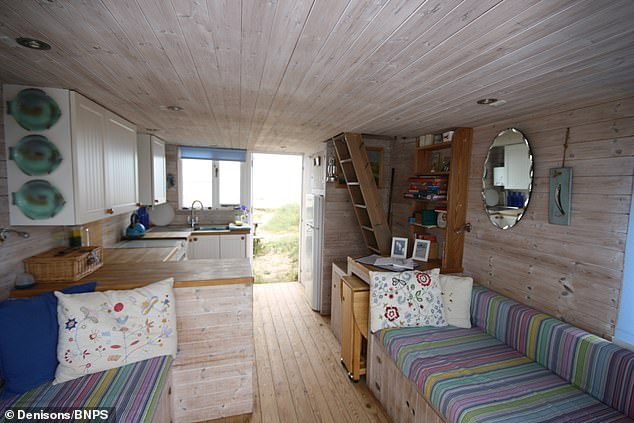 The interior of the £325,000 currently on sale. The huts at Mudeford have no mains electricity or running water and shower facilities are in a shared communal block