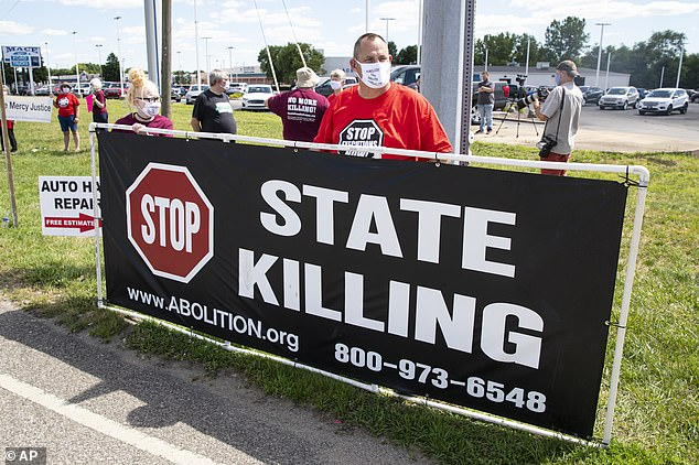 Protesters gathered outside the prison this morning ahead of Lee's execution. The decision to move forward with the execution - the first by the Bureau of Prisons since 2003 - drew scrutiny from civil rights groups and the relatives of Lee´s victims, who had sued to try to halt it, citing concerns about the coronavirus pandemic