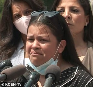 Lupe pictured in tears at a press conference