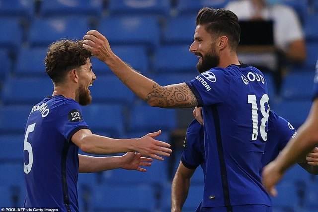 Olivier Giroud celebrates with Jorginho after scoring Chelsea's winning goal on the stroke of half-time against Norwich