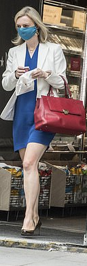 Co-ordinated: A masked Liz Truss exits the same branch