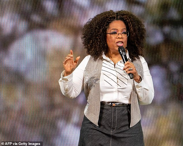 Lending a hand: Oprah has been generously giving back to Americans since the early days of the pandemic (pictured February 2020)