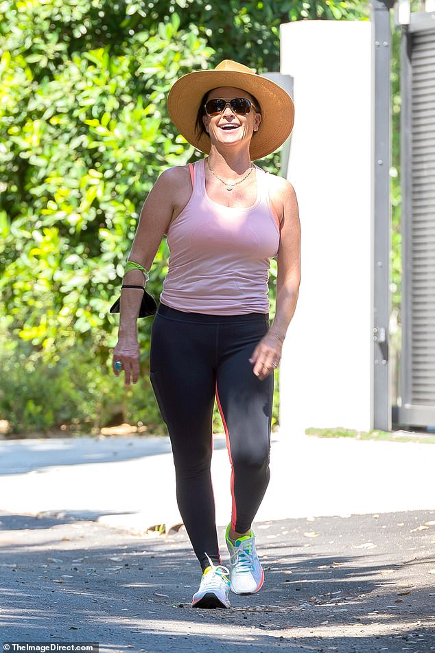Walk this way! Kyle Richards was spotted with a huge smile on her face as she went for a power walk through Los Angeles on her own on Tuesday