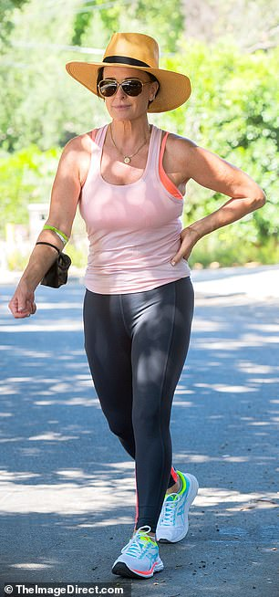 Sporty style:She put her toned arms on display with a light pink tank top, while grey leggings accentuated her fabulous legs