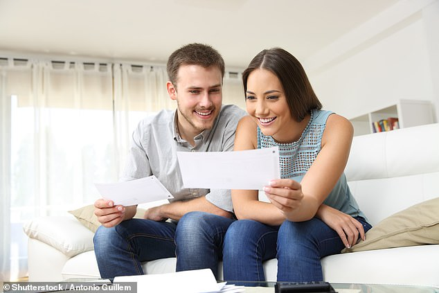 Australians with an average $500,000 home loan can save $6,300 a year simply by ditching the big banks. A record 33,712 borrowers (stock image) refinanced their mortgage in May, a 30 per cent increase in just one month, a Finder analysis of Australian Bureau of Statistics data showed