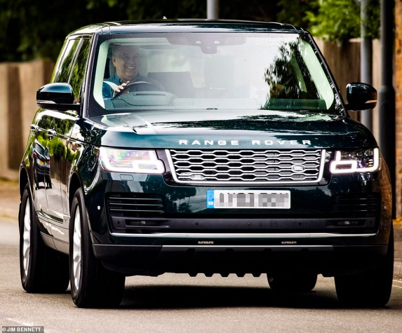 Andrew was laughing and joking with his bodyguard as he drove himself out of Windsor Castle's grounds in his Range Rover