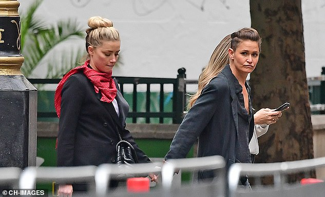 The pair wore the same clothes they had been in throughout the day's court proceedings