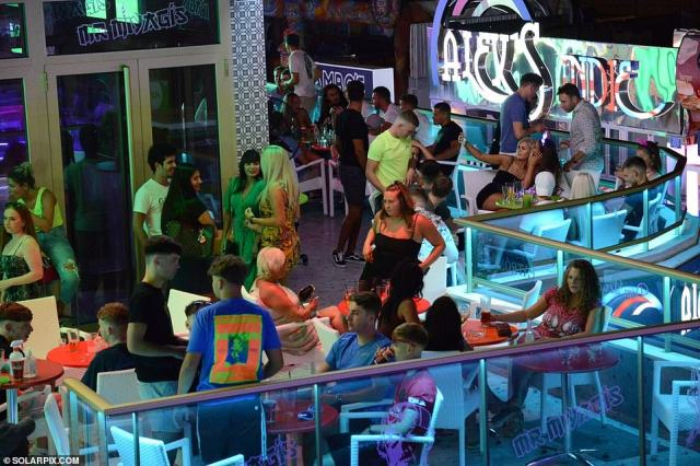 The scenes, which occurred on Friday as police reached the area to make sure bars closed on time, come as concerned residents predicted the problem would only get worse. Pictured: A packed club in Magaluf