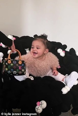 Stormi, who was 22 months old at the time, picked her up and tossed her over her shoulder, which Kylie shared on her Instagram