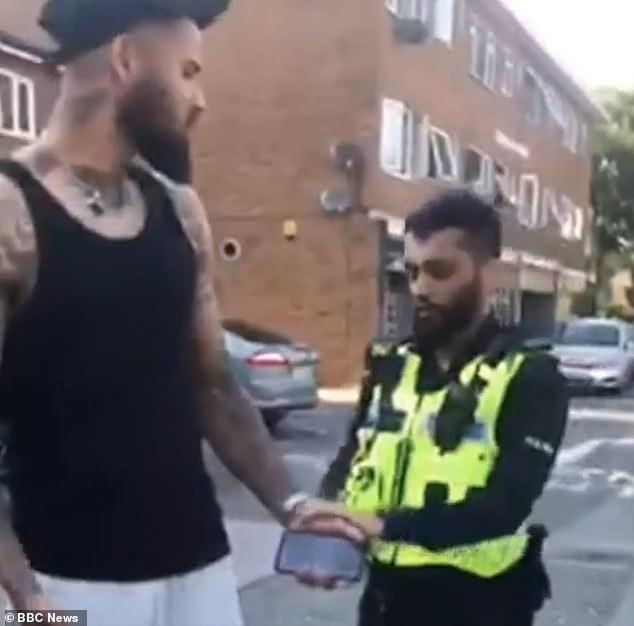 The officer, right, warned Richards-Everton, left, that he was going to be handcuffed during the search