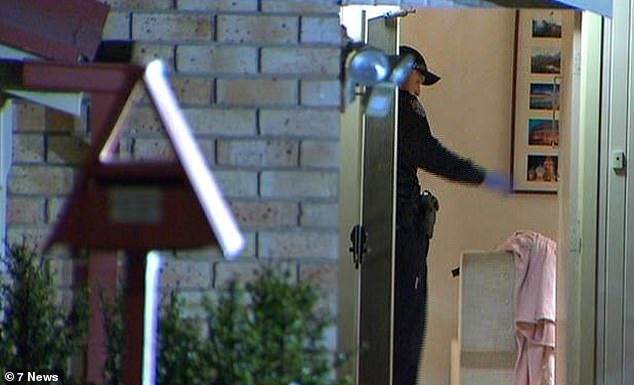 Forensic police were seen examining the home, where they seized a number of items