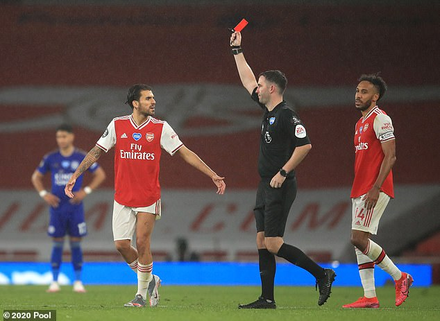 Aubameyang (right) watches Nketiah receive a red card for the challenge after a VAR exam