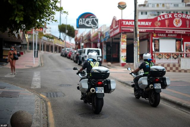"Police patrol an empty street at the resort of Magaluf. In a move designed to stop the spread of the new coronavirus and shake off the region's reputation as a party hub, regional authorities in the Balearic Islands ordered the closure from Thursday of all establishments along Mallorca's ""Beer St."" and ""Ham St."", as the popular party areas near the beach of Palma de Mallorca are known, and another boulevard in nearby Magaluf."