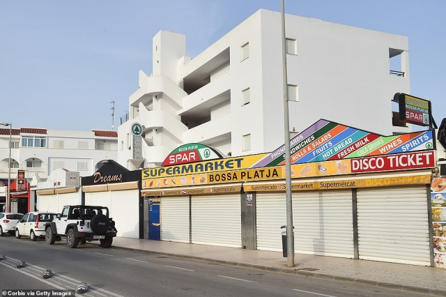 Stores remain shuttered as shops at Playa d'en Bossa on July 14, 2020 in Ibiza are closed to tourists