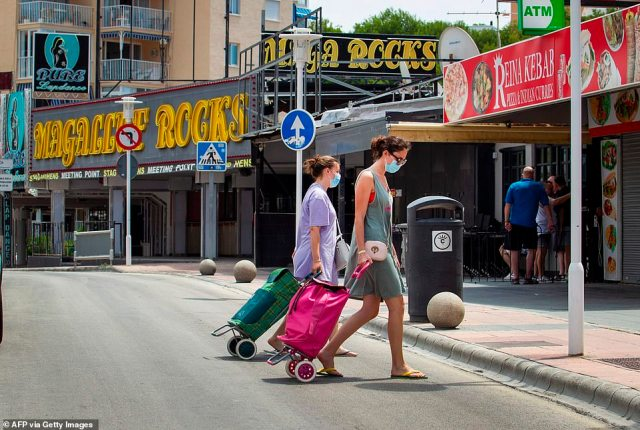 Women walk at Punta Ballena street in Magaluf, Calvia