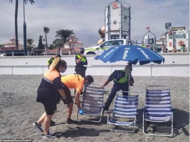 Authorities were seen removing sun loungers and sun umbrellas as they confiscated them