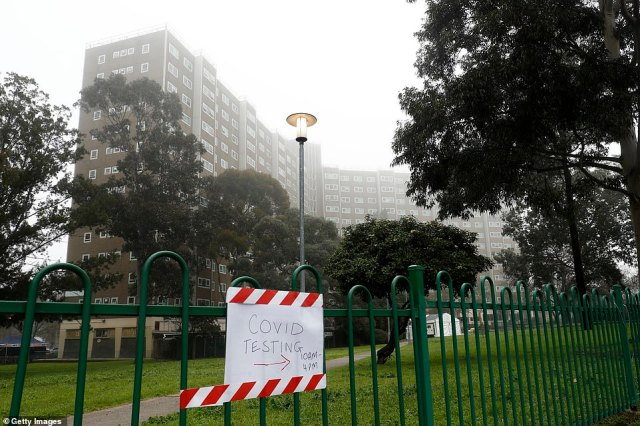 Residents of 33 Alfred Street (pictured) in North Melbourne have been in a 'hard' lockdown for nearly a fortnight, guarded by a large police presence